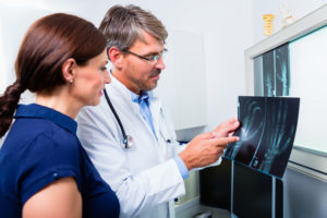 Doctor with x-ray picture of patient hand