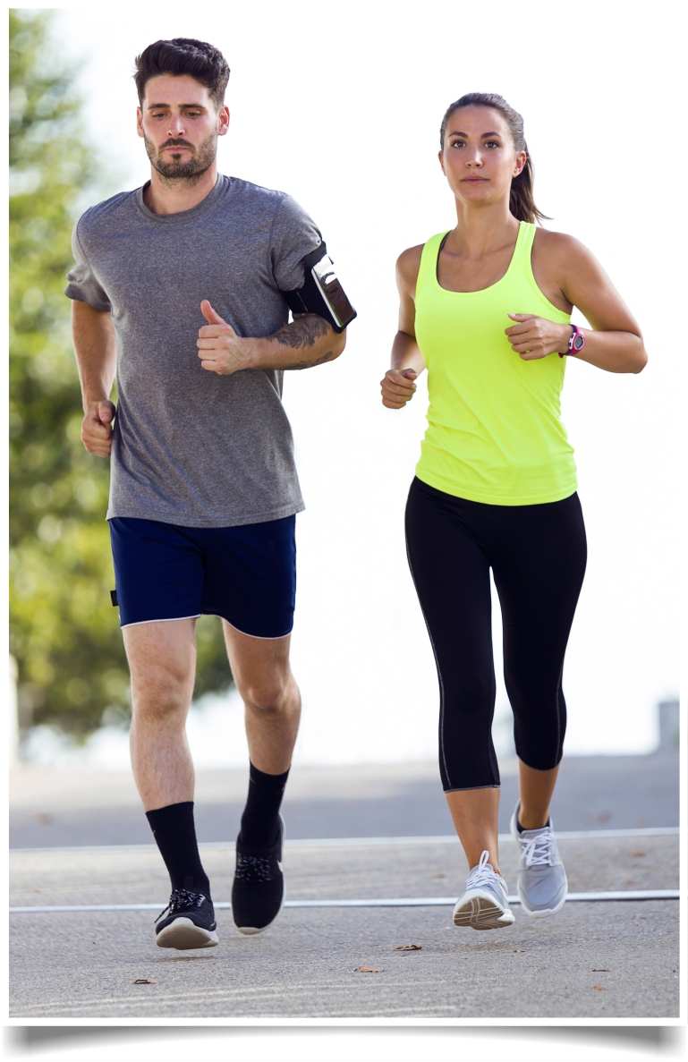 Couple running in street