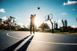 Man shooting basketball on the court
