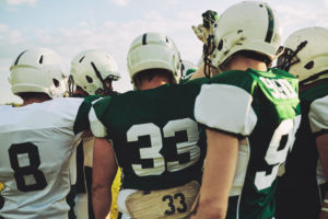 American football team huddling together before a big game